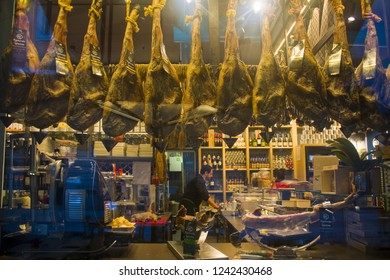 ITALY, MILAN - November 2, 2018: Showcase with hamon hanging on the hook in the store in Milan