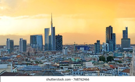 Italy - Milan - November 22,2017 - Duomo cathedral, Vittorio Emanuele Gallery and skyline during the sunset - aerial view