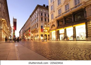 ITALY, MILAN -OCTOBER 23, 2014: unidentified people walk through the shopping street Milan on October 23, 2014