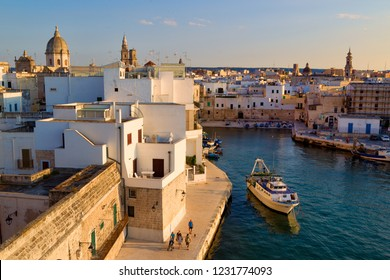 Italy, Monopoli - June 22, 2014: View on Town and Old harbor in Monopoli.