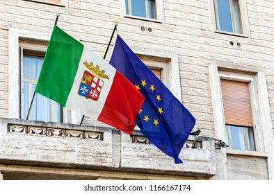 Italy, Naples, the flag of the European Union and the Naval Forces (Marina Militar) of the republic.