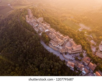 Italy, October 2018 - aerial view at subset of the medieval village of Mondaino in the province of rimini Emilia Romagna. At the foot of the village a hairpin road