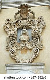 Italy, Padova, antique Ognissanti city door sculpture decoration.