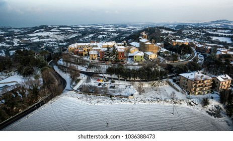 Italy, Pesaro February 2018. Aerial view of the snow-covered medieval village of Novilara