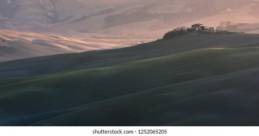 Italy, Pienza - November 24, 2018: Beautiful classic Tuscan landscape at sunrise