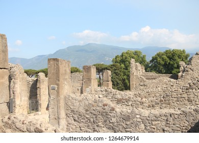Italy, Pompeii - July 14, 2017: View on Pompeii Archaeological Park. Archaeological site of the remains of the iconic Roman city preserved by Vesuvius' ash.