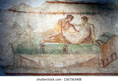ITALY, POMPEII- SEPTEMBER 21, 2010: murals, paintings on the walls in the ruins of Pompeii