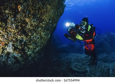 Italy, Ponza Island, Tyrrhenian sea, U.W. photo, filming scuba diver