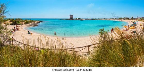 ITALY, PORTO CESAREO - JUNE 08, 2017 : Picturesque Torre Chianca beach and historical fortification tower Torre Chianca (Torre Santo Stefano) on Salento Ionian sea coast, Porto Cesareo, Puglia, Italy.