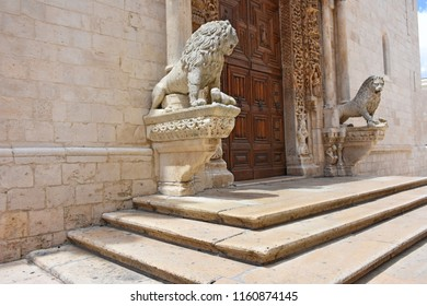 Italy, Puglia region, Altamura, 24 June 2018, Cathedral of Santa Maria Assunta, gate and sculptures of the main façade. Medieval steps at the entrance