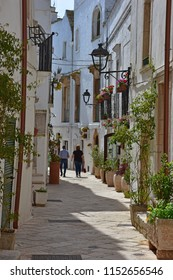 Italy, Puglia region, Locorotondo, 1 May 2018, a whitewashed village in the Itria valley, with its medieval historical center full of stairs, balconies, flowers, arches, frescoed churches, and details