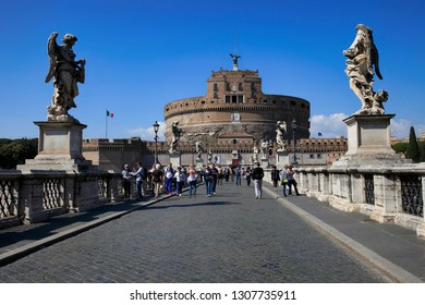 Italy, Rome, April 20, 2015. On a sunny day a view of Saint Angelo Castle and Saint Angelo Bridge over Tiber River