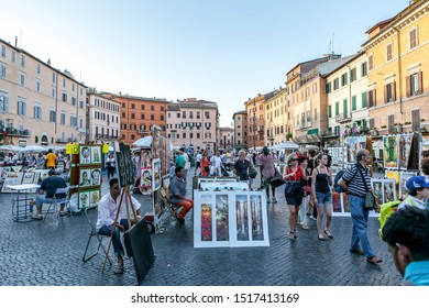 Italy, Rome, August 6, 2011: street artist in Piazza Navona in the evening.