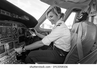 Italy, Rome, Ciampino International Airport; 26 July 2010, female pilot in the cockpit of an airplane on the runway - EDITORIAL