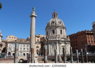 Italy, Rome - July 12, 2017: View on Trajan's Column and catholic church Chiesa del Santissimo Nome di Maria al Foro Traiano,