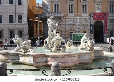 Italy, Rome - July 12, 2017: View on Moor Fountain on Piazza Navona. The fountain was originally designed by Giacomo della Porta in 1575 with the dolphin and four Tritons.