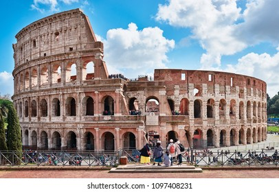 Italy, Rome, March 13 / 2018 Colosseum seen from the archaeological site square Francesca Romana, tourists admire the Colosseum