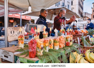 Italy, Rome, March 8/ 2018 traditional outdoor food market of Campo de Fiori (fields of flower), fruit stand and fruit juices