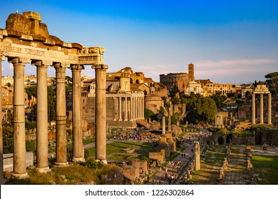 Italy. Rome. The Roman Forum (Forum Romanum) bathed in the sunset light. There is remains of the Temple of Saturn in the left