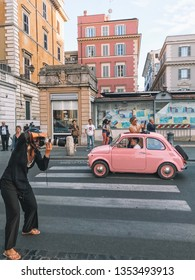 ITALY, Rome - September 17, 2017: A photographer takes a photo of Festival Fiat 500 Rally takes place on Rome, Italy