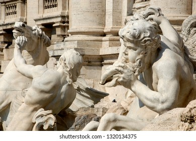 Italy / Rome – September 22, 2009:  the Trevi Fountain is the largest and most famous fountain in Rome. Beautiful details of the horses led by Oceano.