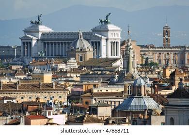 "Italy. Rome. View on Monument of Vittorio Emanuele II (The ""Vittoriano"" or Altare della patria) and Rome roofs and domes"