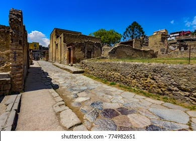 Italy. Ruins of Herculaneum (is on UNESCO World Heritage Site) - Decumanus Inferior (lower Decumanus street) and house with the Large Doorway