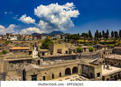 Italy. Ruins of Herculaneum (UNESCO World Heritage Site) - general view. There is Mount Vesuvius in the background