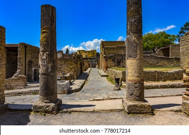 Italy. Ruins of Herculaneum (UNESCO World Heritage Site) - Crossing of Cardo V and Decumanus Inferior (lower Decumanus street) seen from Palestra