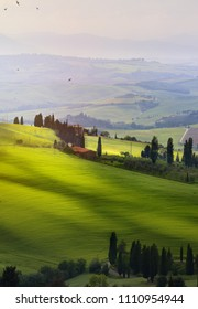Italy; San Quirico d'Orcia; sunset over Tuscan Valdorcia rolling hills