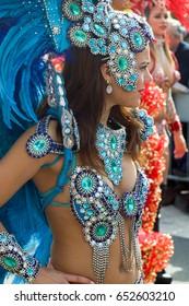 ITALY, SANREMO - MARCH 12, 2017 the spring parade, beautiful female street artist, brazilian dancer in multicolored costume