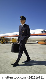 Italy, Sardinia, Olbia International Airport, male flight assistant unboarding