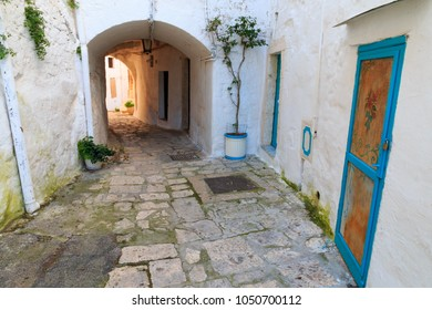 """Italy, SE Italy, Ostuni. Narrow, arched old town . Blue Doorways.The """"White City."""""""
