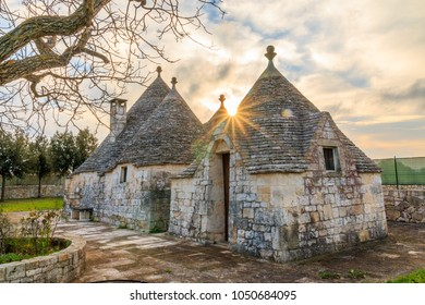 Italy, SE Italy, Region of Apulia, Province of Bari, Itria Valley,  Alberobello. A trullo house is a Apulian dry stone hut with a conical roof. UNESCO Heritage site.  November 24, 2016