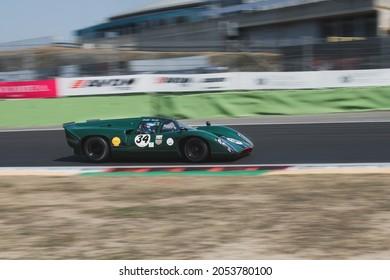 Italy, september 11 2021. Vallelunga classic. 70s vintage race car prototype endurance blurred motion background  LOLA T70 on asphalt racetrack