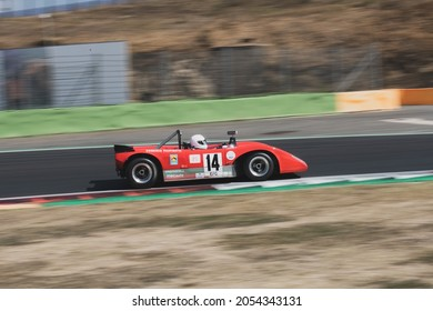 Italy, september 11 2021. Vallelunga classic. 70s vintage race car prototype endurance blurred motion background  LOLA T212 on asphalt racetrack
