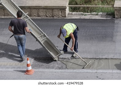 Italy, Sicily; 12 May 2016, men at work fixing a road - EDITORIAL