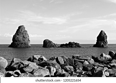 Italy, Sicily: Cyclops bay in black and white.