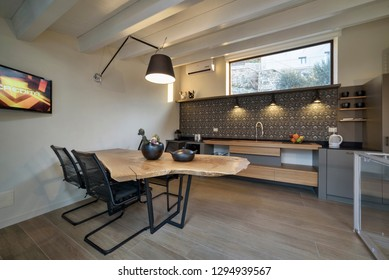 Italy, Sicily, Donnalucata (Ragusa Province); 15 April 2015, apartment kitchen and dining table - EDITORIAL