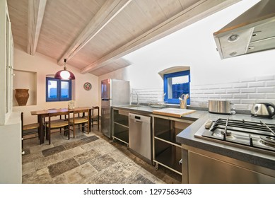 Italy, Sicily, Donnalucata (Ragusa Province); 20 April 2018, apartment kitchen and dining table - EDITORIAL