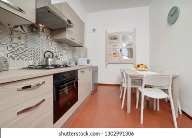 Italy, Sicily, Kaukana (Ragusa Province); 5 June 2018, house kitchen and dining table - EDITORIAL
