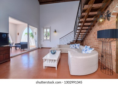 Italy, Sicily, Kaukana (Ragusa Province); 5 June 2018, house living room with stairs to the upper level bedrooms - EDITORIAL