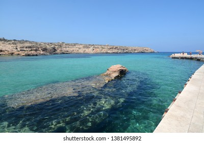 Italy, Sicily / Lampedusa – July 13, 2015: Transparent and blue water in the sea of Lampedusa at Cala Pisana. The Pelagie Islands are the southernmost point of Italy in Sicily.