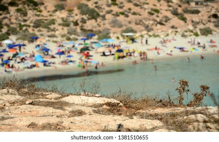 Italy, Sicily / Lampedusa – July 13, 2015: Transparent and blue water in the sea of Lampedusa at the Rabbits beach. The Pelagie Islands are the southernmost point of Italy in Sicily.