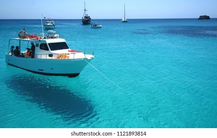 Italy, Sicily / Lampedusa – July 14, 2015: Transparent and blue water in the sea of Lampedusa at the beach of the Rabbits. The Pelagie Islands are the southernmost point of Italy in Sicily.