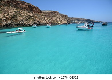 Italy , Sicily / Lampedusa – July 14, 2015: Transparent and blue water in the sea of Lampedusa at the Rabbits beach. The Pelagie Islands are the southernmost point of Italy in Sicily.