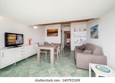 Italy, Sicily, Marina di Ragusa (Ragusa Province); 27 April 2019, elegant private apartment, living room - EDITORIAL