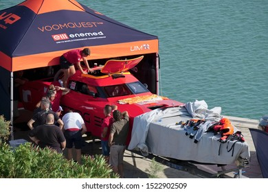 Italy, Sicily, Marina di Ragusa (Ragusa Province); 3 October 2019, Italian Offshore Championship, people and an Offhore boat in the port - EDITORIAL
