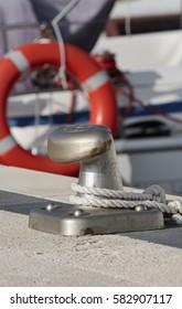Italy, Sicily, Marina di Ragusa, bollard and nautical ropes in the port
