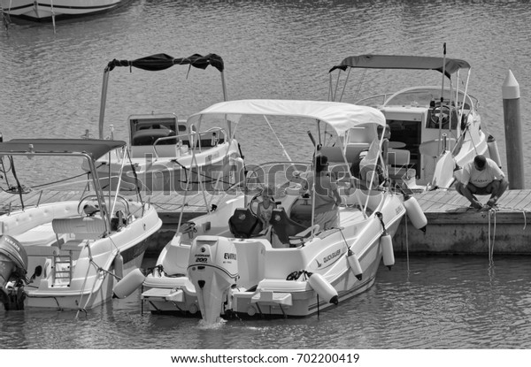 Italy, Sicily, Mediterranean Sea; 24 August 2017, people on a motor boat in the port - EDITORIAL